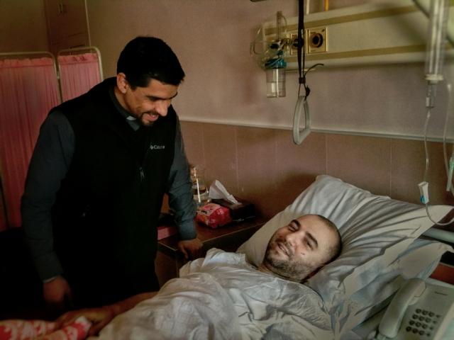 Rami with Fr. Rodrigo in the hospital (Rami was always smiling!)